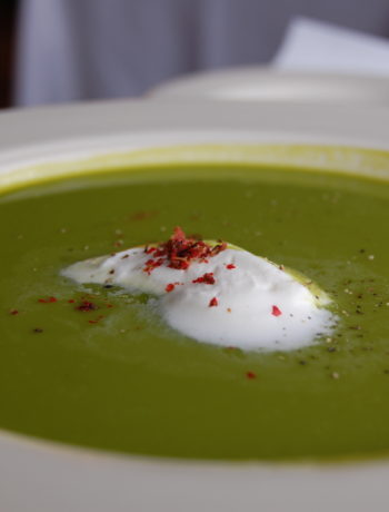 Asparagus soup, blended to velvety smoothness and finished with creme fraiche and pink peppercorns