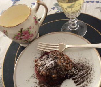 Amaretti Stuffed Peach served with single cream and a glass of Moscato
